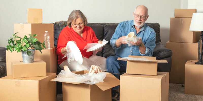 senior couple packing for the move