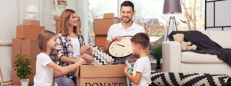 entire family packing their household items in a cardbox