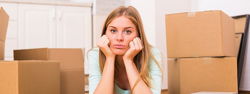 Beautiful woman looking stressed about her relocation