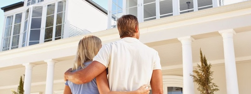 young couple inspecting a property before buying